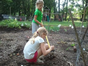 Anna and Claire Plant a Row for the Hungry